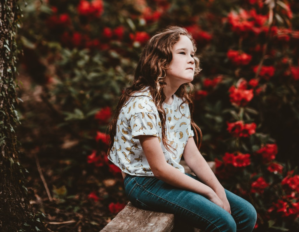 Thoughtful girl sitting on a bench