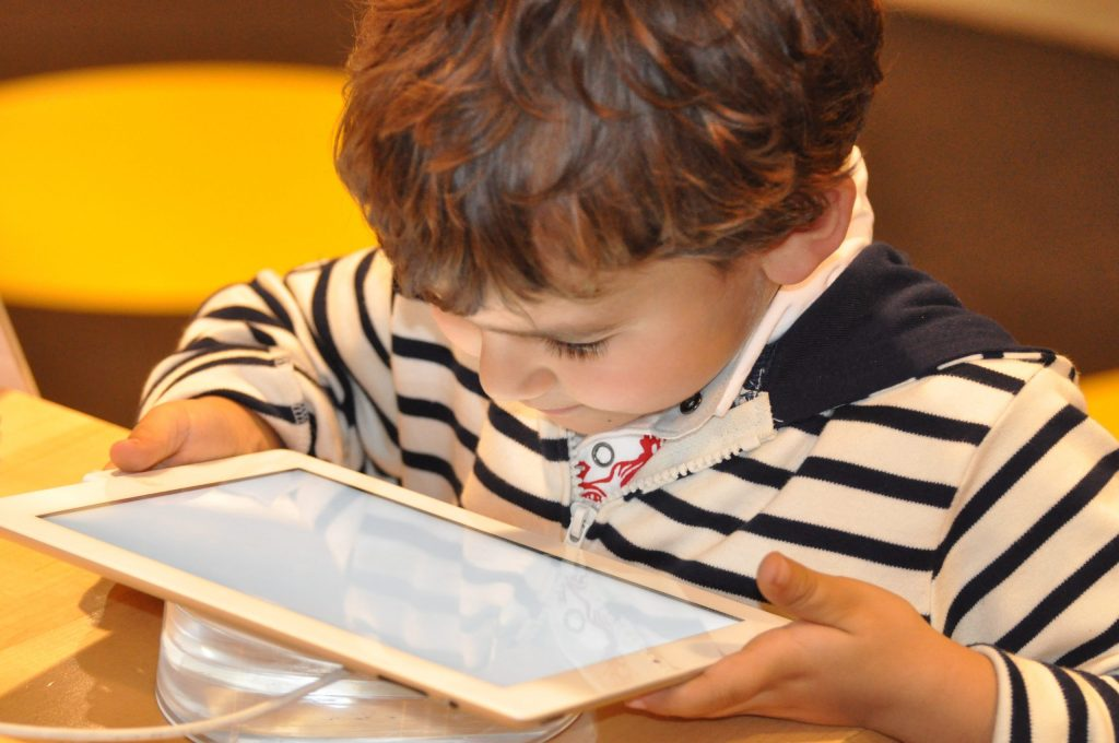 young boy on a tablet for online learning