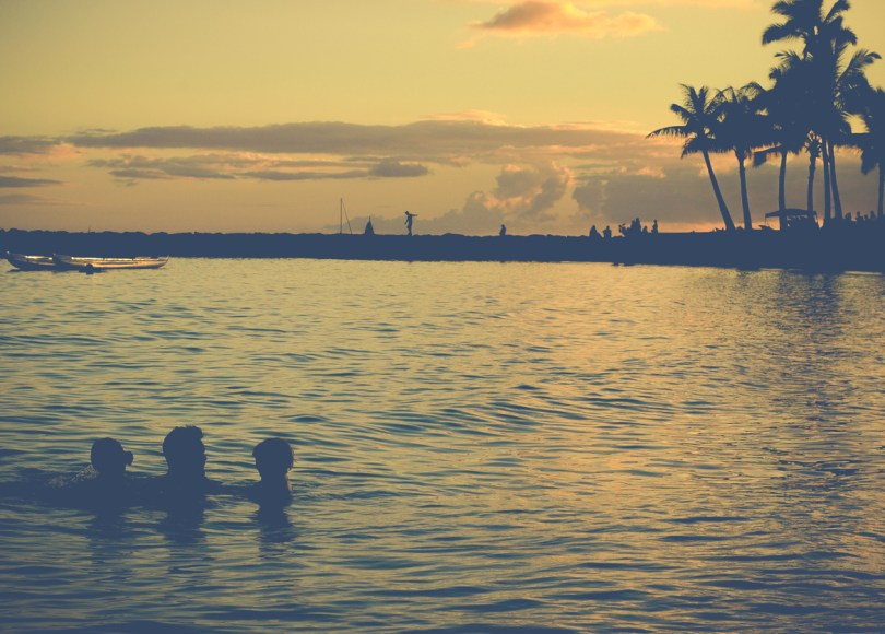 family enjoying their summer at the beach