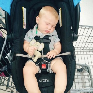 Sleeping in the Binxy Baby , in his carseat while we grocery shop