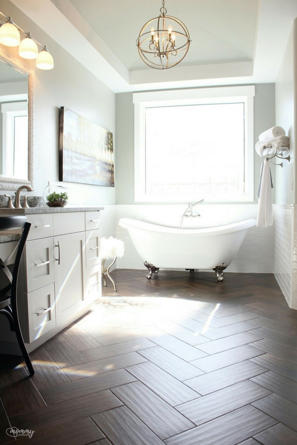 Clawfoot tub. Wood tile in the bathroom. Gorgeous bath ideas. St. George Parade of Homes 2017
