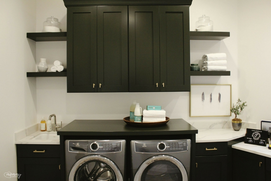 Modern Laundry room. Black cabinets with gold hardware. Parade of homes 2017 tour. Young mom's look at the st george parade of homes. 2017 Parade of homes.