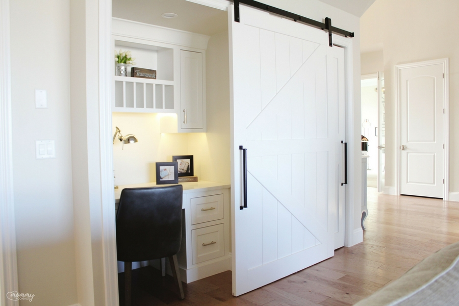 A sliding barn door over a little office space, right in the kitchen. you can keep track of all the papers, but not EVERYBODY needs to see it! kitchen office for moms