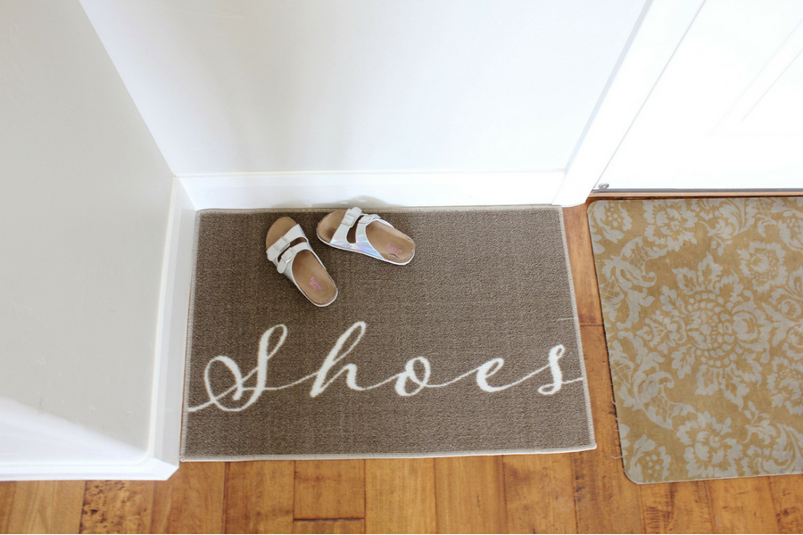 How to get people to remove their shoes! Several effective ways to remind people to take off their shoes inside the home. Then once their off? Game changing shoe organizing ideas! #shoeorganizers #shoesystems #shoerug #shoecabinet