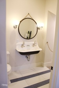 antique double sink, round black mirror, two-tile bathroom, navy tile. black bottom sink. parade of homes 2019