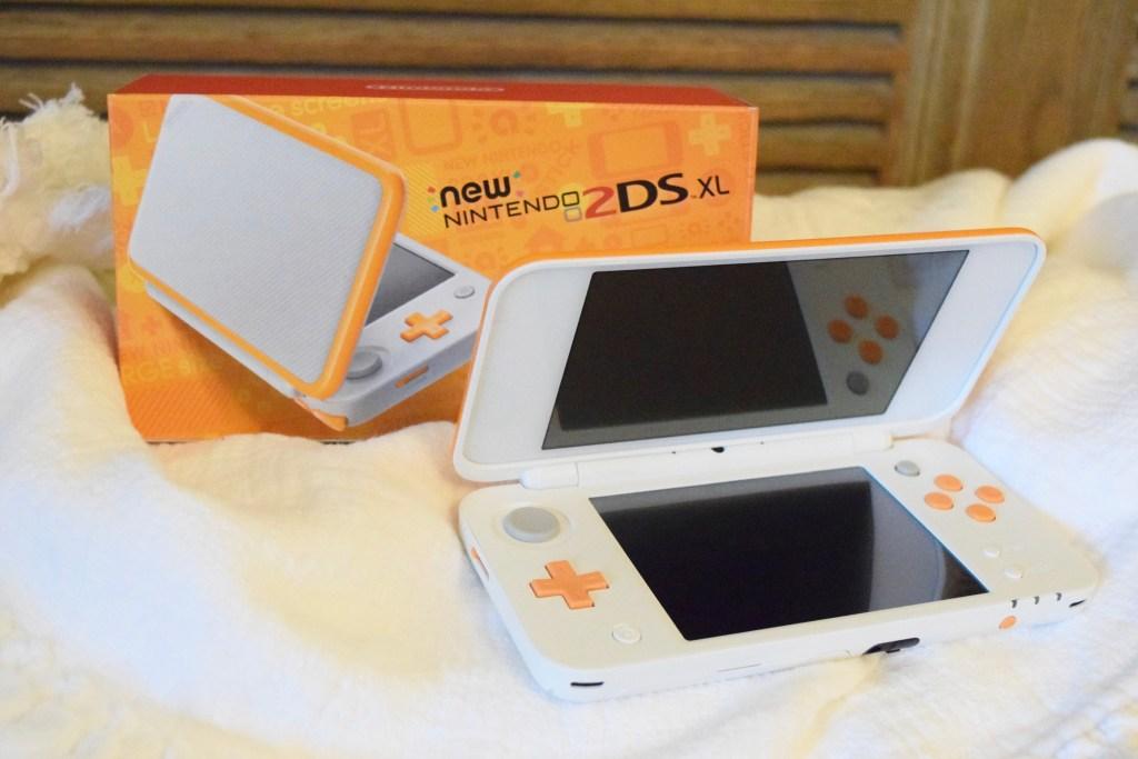 Orange and white Nintendo 2DS XL