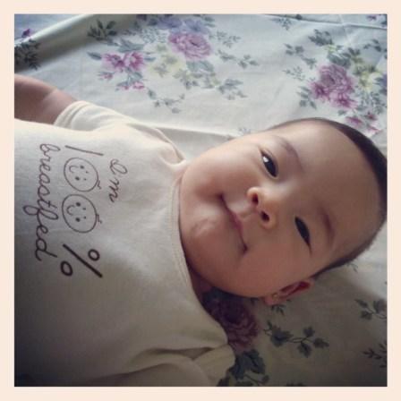 Baby Z in her St. Patrick Onesie