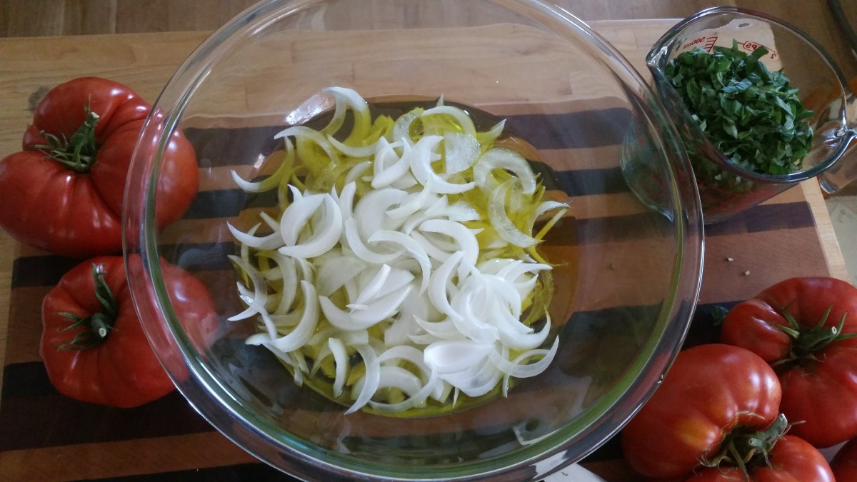 Sliced onions added to the Italian Bread Salad.