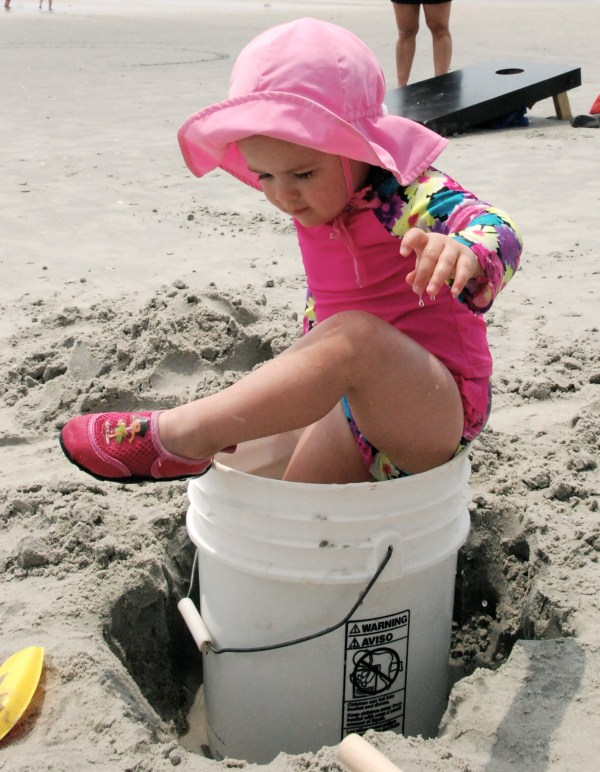 They also spent a while playing in a bucket of water.  Here's Addison trying to get out...