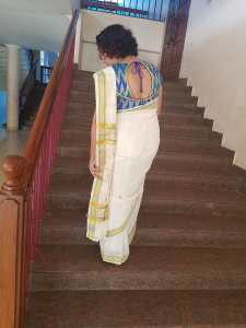 what to wear to a kerala wedding, kasavu saree, set saree, traditional kerala dress, white and gold kerala saree, kasavu kada, malayali wedding saree, hindu mallu saree, traditional south indian saree