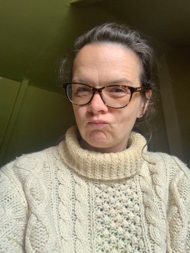 The author in an old cable-knit sweater.