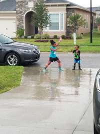 Boy and Girl playing in the rain