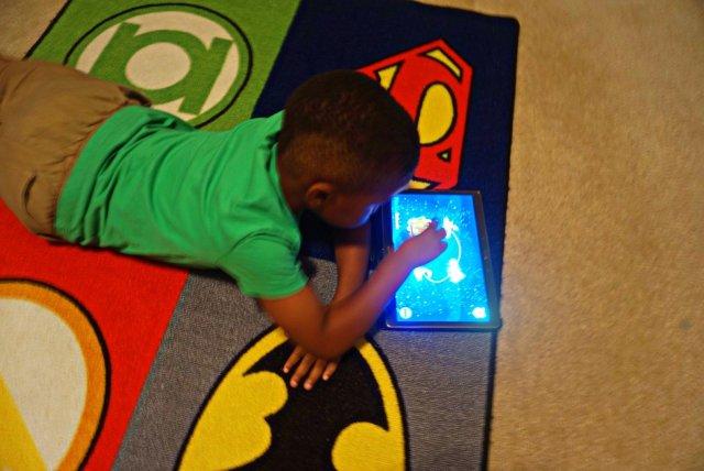 Child enjoying reading app