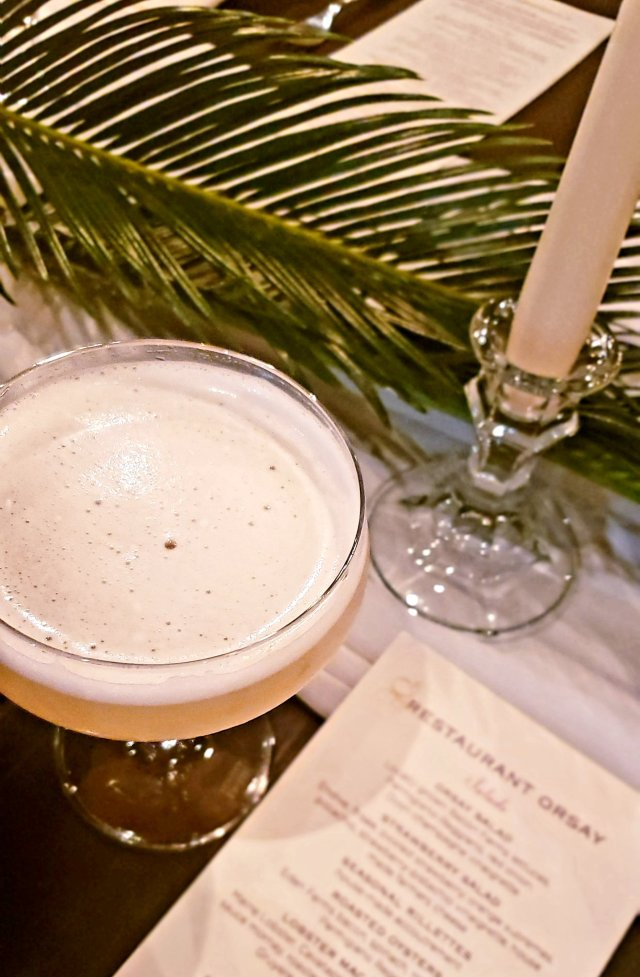 Drink on place setting with candle and leaf decor