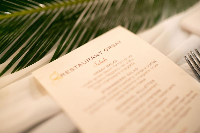 Orsay Jax Menu with green leaves in the background