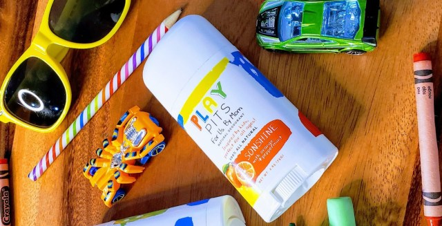 Play Pits Kids deodorant with crayons cars and sunglasses scattered