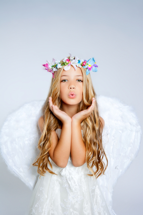 Angel little girl blowing expression with wings