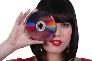 woman holding a compact disk