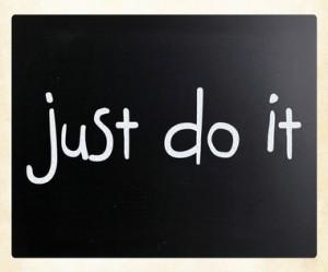 """Just Do It"" handwritten with white chalk on a blackboard"