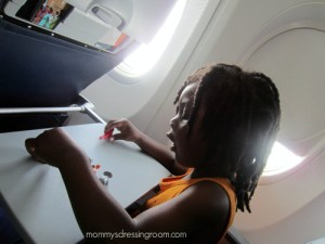 Zion playing with toys on the plane