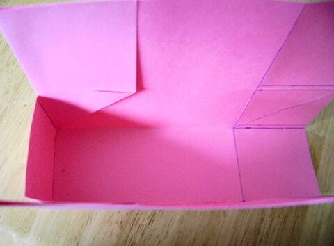 """Fold along the 2"""" column and glue the 2.5"""" boxes to the paper."""