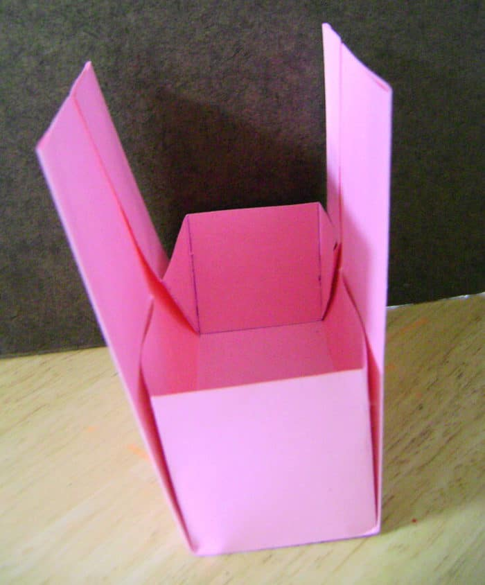 """Fold the diagonal fold, up to the 2.5"""" square and glue."""