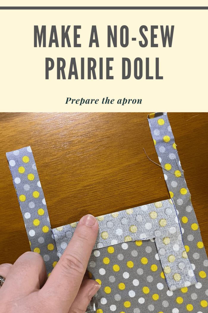 To begin, fold the centerpiece of the printed fabric down and press it with your fingers.