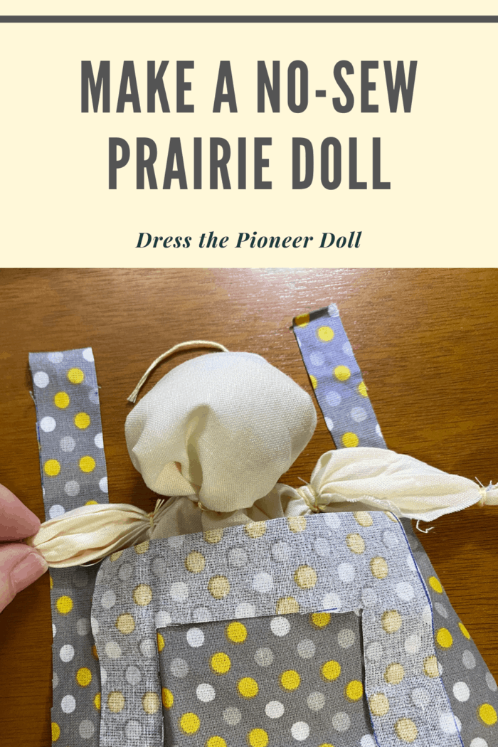 Tuck the OUTSIDE tie under the doll's arm and tie it over the shoulder.