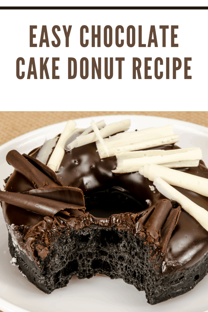 chocolate cake donut embellished with white chocolate curls with bite taken