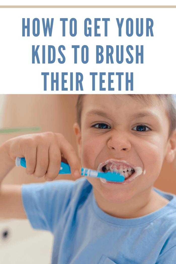 small boy in blue shirt brushing teeth
