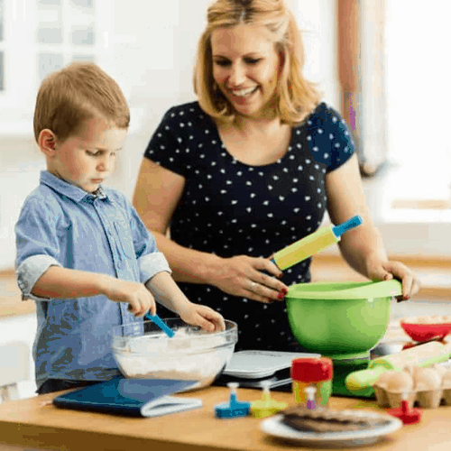 single parent making dinner with child