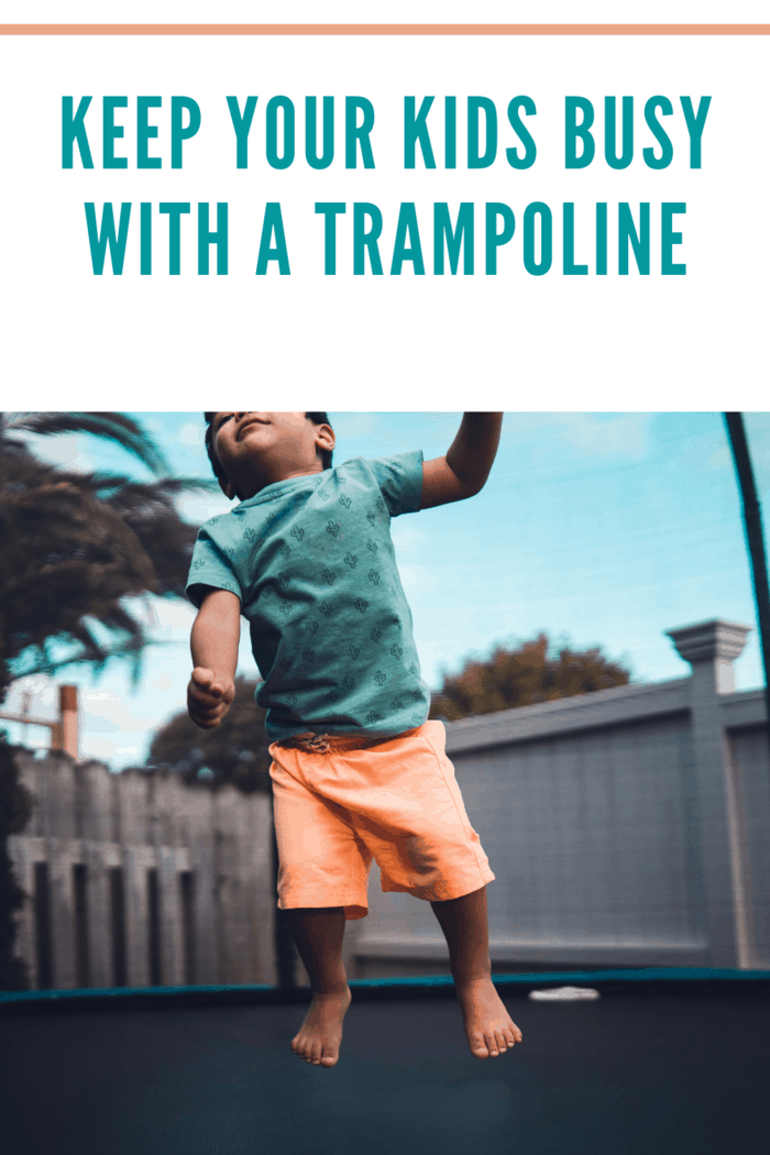 small boy jumping on a trampoline keeping busy