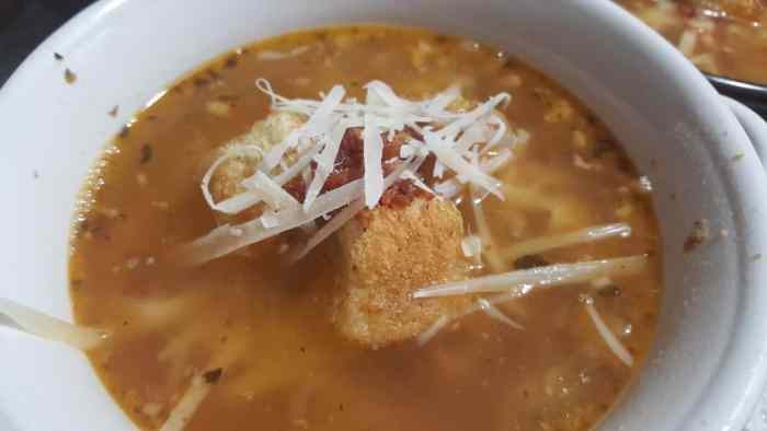 serving hearty tuscan bean soup