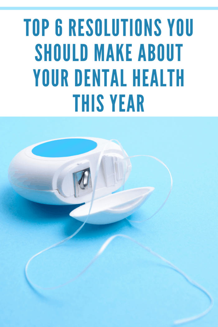 dental floss laying on side with floss pulled out