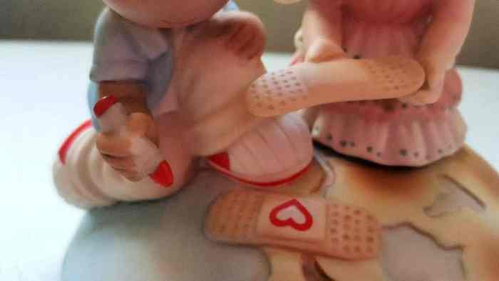precious moments be the change you want to see in the world close up of bandaid (1)
