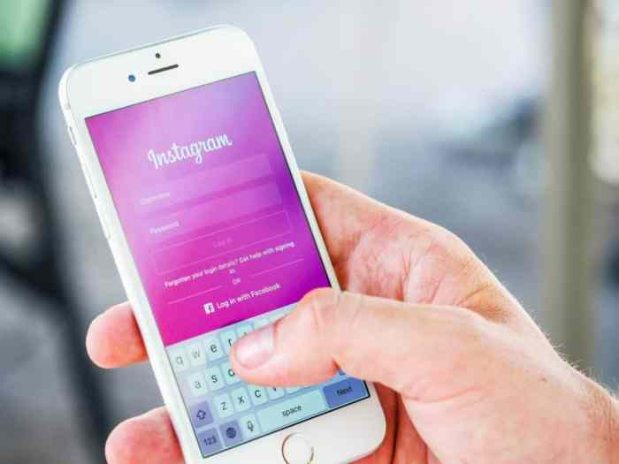 mobile phone with user getting ready to log into instagram features and upload photos to instagram