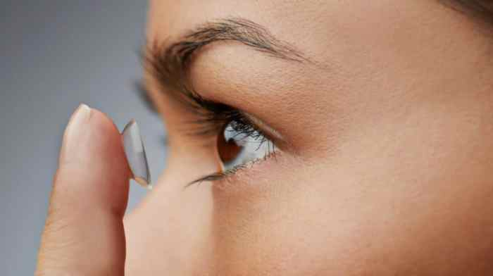 contact lenses being put into eye