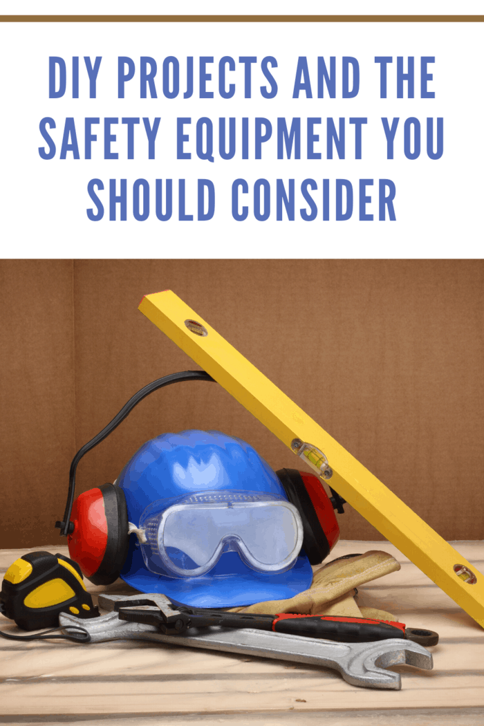 safety gear protective eyewear, protective earphones, hard hat with level