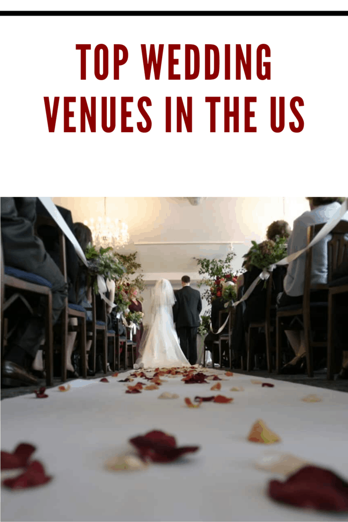 bride walking down the aisle at wedding venue with rose petals scattered