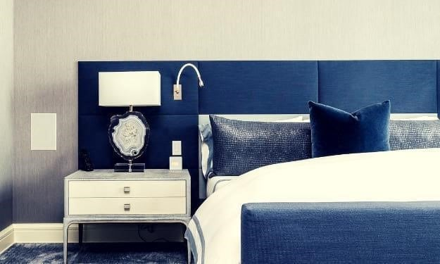 navy headboard and footboard of bed with white duvet