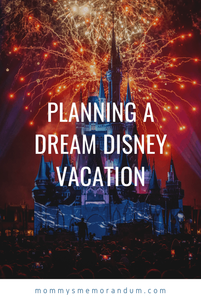 disney princess castle with red and orange fireworks in the sky behind it