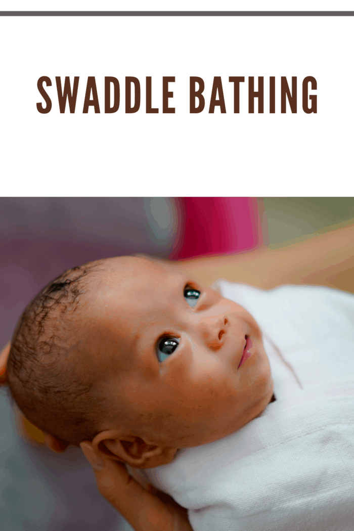 For swaddle bathing, you'll wrap your baby up in a light blanket, and carefully uncover one limb at a time.