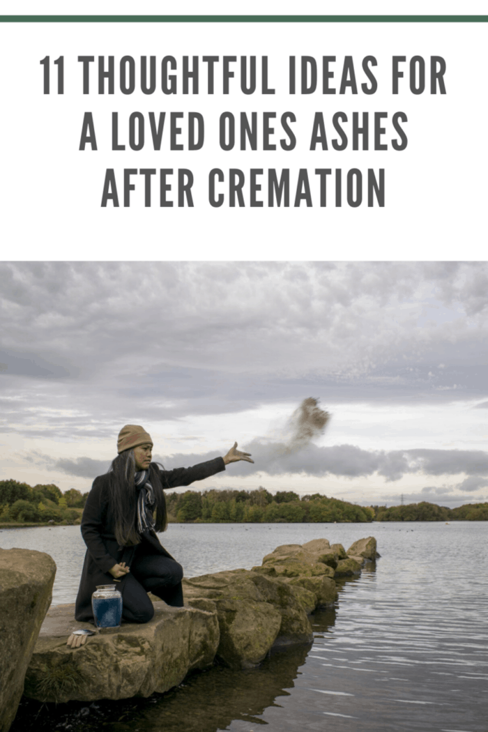 woman on rocks spreading loved ones ashes over lake