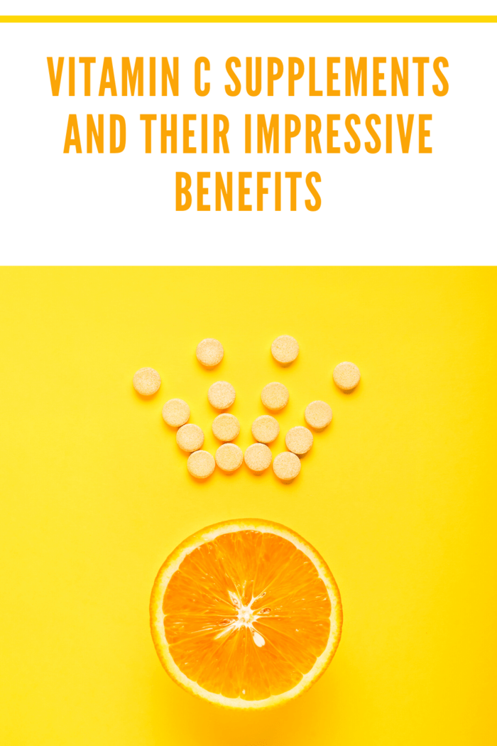 vitamin c supplements forming a crown over an orange slice
