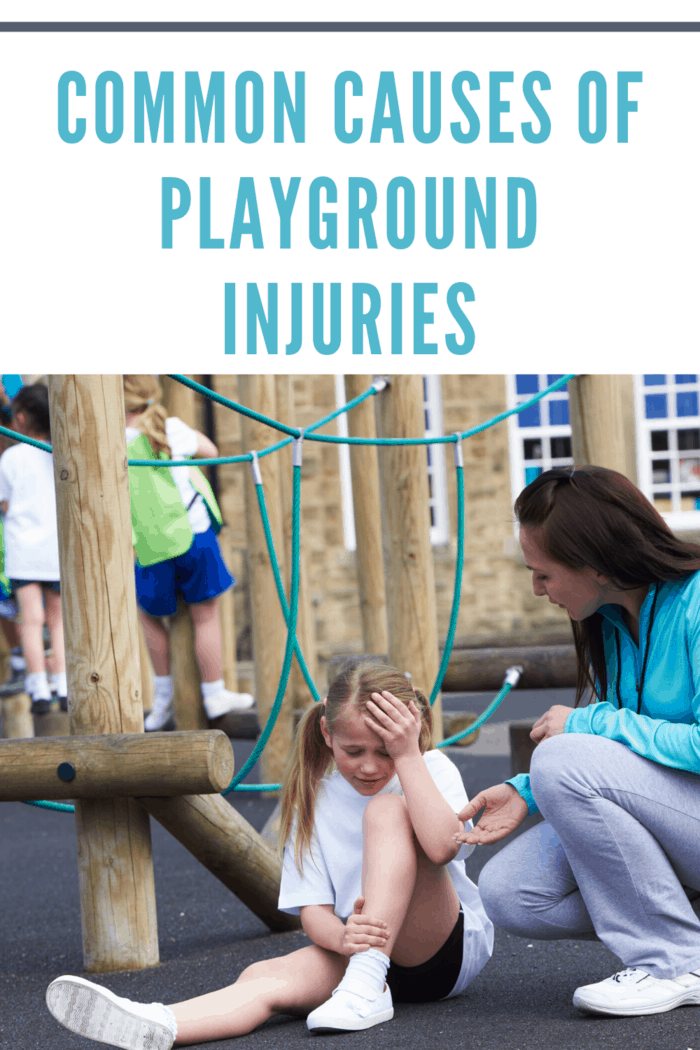 woman helping little girl injured in playground