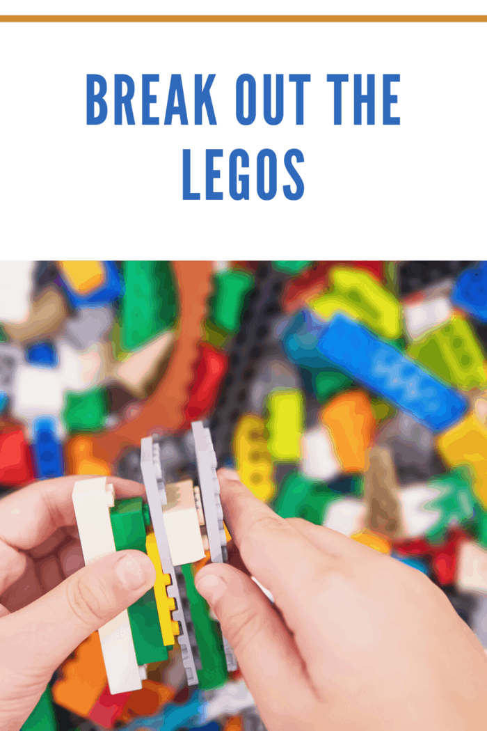 child connecting LEGOS