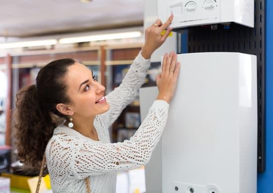 Woman buying heating water boiler