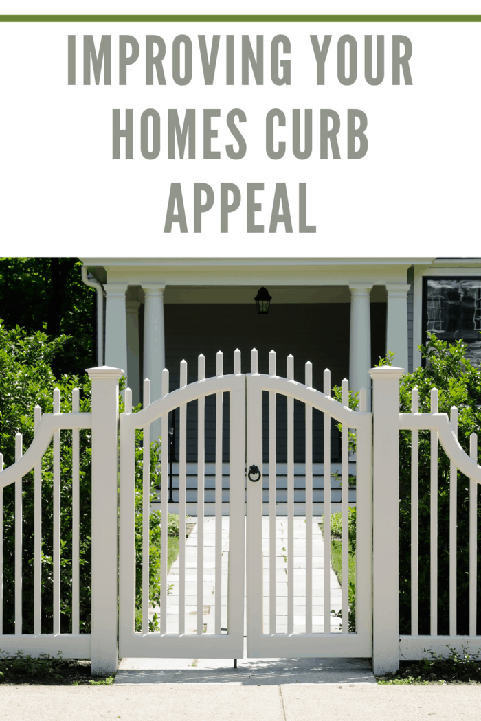 white picket fence in front of home
