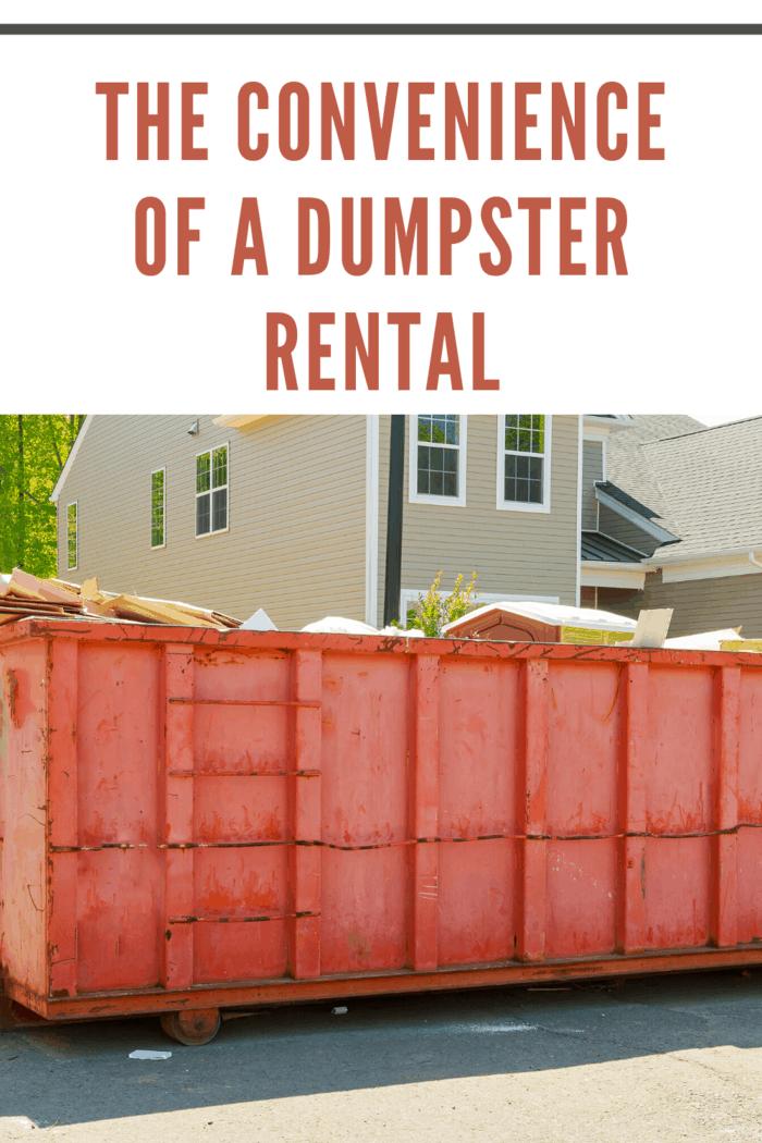 orange dumpster rental in front of apartments