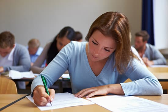 Young woman taking test in job assessment center